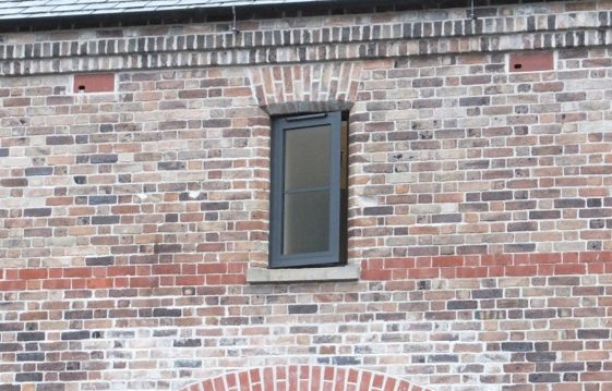 Swift boxes made to look like bricks, incorporated into the Antrim Castle brickwork just under the roof line.
